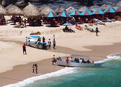 vamos a la playa caliente el sol  (uteart) Tags: beach mexico boats jalisco jungle tropical umbrellas palapas mismaloya uteart vamosalaplayacalienteelsol