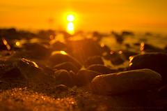 sunrise (volen76) Tags: sea orange beach stone sunrise lens nikon gimp baltic manual cto gdynia orowo orangefilter d7000 smsls nikkornauto128f24mmnipponkogakujapan