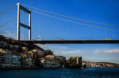 Crossing (Melissa Maples) Tags: bridge blue sky water turkey nikon asia trkiye istanbul nikkor strait bosphorus vr afs  18200mm  f3556g  18200mmf3556g d5100