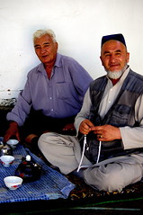 Friends in Teahouse (Tomas Pfeifer) Tags: friends kyrgyzstan teahouse arslanbob