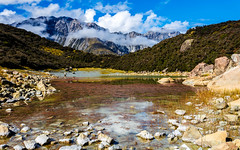 Alpine Beauty (djryan78) Tags: travel blue autumn trees newzealand cloud mountain lake mountains tree fall water rock clouds canon reeds landscape pond rocks cloudy outdoor lakes canterbury mackenzie mtcook southisland dslr bluelake 1740 6d mountcook aoraki 1740l mtcooknationalpark bluelakes aorakimtcook tasmanvalley aorakimtcooknationalpark canon6d