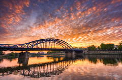 """It is almost impossible to watch a sunset and not dream."" (traumlichtfabrik) Tags: city trip travel bridge sunset sky orange horizontal architecture clouds river evening spring sonnenuntergang pentax outdoor dusk weekend urlaub wolken sigma poland krakow journey stadt polen serene brcke fluss 1770 krakw hdr vistula k5 wisla kazimierz reise frhling pl krakau 2016 photomatix weichsel maopolskie"