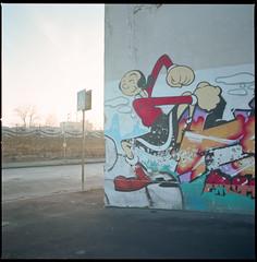 (No Spinach) (Robbie McIntosh) Tags: 120 6x6 film wall mediumformat square landscape graffiti factory kodak decay hasselblad negative popeye dyi ektar c41 pellicola hasselblad500cm selfdevelopment mittelformat moyenformat filmisnotdead medioformato newtopographics tetenal homedevelopment colortec autaut kodakektar100 tetenalcolortecc41 carlzeissdistagon50mmf4ct oliviaoyl