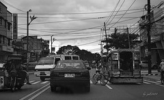 Brave Biker (jed52400) Tags: street blackandwhite bike buildings philippines vehicles trafic marikina tricycles philippinejeepney motorists
