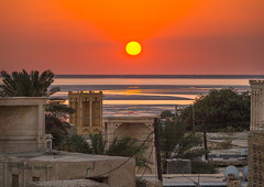 sunset over wind towers used as a natural cooling system in iranian traditional architecture, Qeshm Island, Laft, Iran (Eric Lafforgue) Tags: city travel sunset urban sun building tower tourism horizontal architecture outdoors photography persian asia day desert iran traditional towers middleeast culture persia bluesky nobody architectural catcher orient cultural persiangulf windcatcher windtower badgir qeshmisland laft hormozgan coolingsystem  buildingexterior   iro straitofhormuz  builtstructure colourpicture  iran034i8256