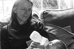 home iii. (giakasam) Tags: portrait blackandwhite baby film monochrome nikon infant grandmother naturallight nikkormat