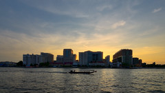 Siriraj Hospital (Rotationism) Tags: city travel blue sunset sky people color tower water beautiful skyline architecture night hospital river landscape thailand design boat town twilight construction asia cityscape place dusk bangkok background famous structure government service southeast chao phraya siriraj