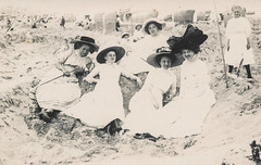 Women in fancy hats sitting on the beach (simpleinsomnia) Tags: old woman white black beach monochrome hat umbrella vintage germany found outside blackwhite sand antique snapshot photograph vernacular lbeck edwardian foundphotograph parisol