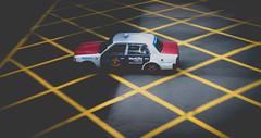 HK.Taxi.Half.Light (Jeremy Langley) Tags: street light shadow hk sunlight blur car yellow outdoors grid hongkong drive driving crossing cross box cab taxi hong kong cabride metlife sar taxiride hksar yellowgrid hongkongtaxi