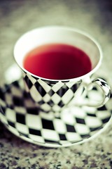 Fruity Harlequin (The Green Album) Tags: red geometric cup kitchen fruit healthy strawberry pattern tea drink worktop granite liquid saucer harlequin
