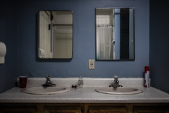 Dual Sinks (Evan's Life Through The Lens) Tags: camera light shadow college glass 35mm dark lens bathroom photography mirror photo sink sony dirty t15 rokinon a7s