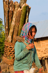 Girl carrying firewood (Laura Jacobsen) Tags: laos hilltribe akha phongsaly phongsali akhanoukouy