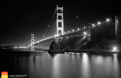 Night-at-Golden-Gate (Nualchemist) Tags: sanfrancisco light blackandwhite water night landscape lights bay rocks noir moody horizon landmark goldengatebridge goldengate mysterious sanfranciscobay lowkey iconic symbolic darksky slowshutterspeed fortbaker smoothwater silkywater sanfranciscosymbol iconicbridge nightlyskywideangle