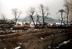 31-552 (ndpa / s. lundeen, archivist) Tags: trees houses homes winter house snow color building fall film home field rural 35mm buildings snowy nick hill korea farmland korean seoul thatchedroof 1970s southkorea 1972 31 lightsnow dewolf traintrip thatchroof fromthetrainwindow nickdewolf photographbynickdewolf fromapassingtrain reel31