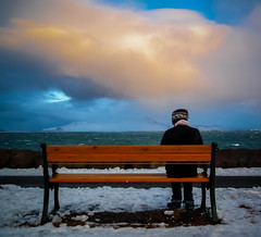 Seated Man in Winter (Reykjavik, Iceland. Gustavo Thomas  2013) (Gustavo Thomas) Tags: winter cloud snow man cold colour bench iceland islandia hiver north reykjavik invierno seating seated fro froid nube homme