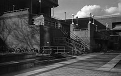 East Campus Mall (patrickkuhl) Tags: street leica blackandwhite building film monochrome wisconsin architecture analog 35mm mall campus blackwhite kodak streetphotography east d76 summicron madison uwmadison filmcamera madisonwi 40mm wisco selfdeveloped m4p wisc filmphotography summicronc leitz kentmere filmisnotdead kodakd76