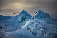 Twin Peaks Castor 4230 & Pollux 4094 in the shaded morning sun (iSteven-ch) Tags: mountain snow alps ice clouds switzerland cloudy peak glacier gornergrat zermatt ch castor valais pollux dimlight