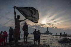 At Kanyakumari (Ravikanth K) Tags: morning people men water statue rock sunrise memorial wind outdoor air windy clothes southern tip idol cape drying kanyakumari thiruvalluvar lungi vivekananda kanniyakumari comorin 500px nikond750