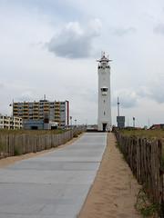 20090606_Netherlands_0005.jpg (Ryan and Shannon Gutenkunst) Tags: sky lighthouse netherlands clouds sand beachatnoordwijk