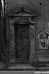 Abandoned Doorway (SCOTTS WORLD) Tags: door city trees winter shadow urban blackandwhite usa detail building brick abandoned architecture digital america graffiti march weeds midwest arch unitedstates pov decay michigan empty exploring urbandecay detroit perspective entrance creepy panasonic spooky adventure sidewalk modified weathered exploration blight dilapidated urbanexploring urbex 313 motown motorcity 2016