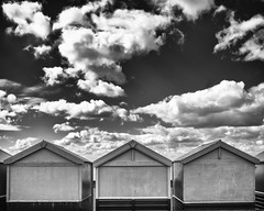 Cloud Nine (Fourteenfoottiger) Tags: sky blackandwhite beach monochrome clouds contrast dark coast three moody dramatic wideangle stormy dirty huts promenade brooding trio triple beachhuts cloudnine grimy
