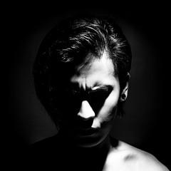 Monochrome Selfie. (Miyata Shota) Tags: shadow portrait man male monochrome strobe onelight lightinthedark