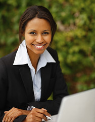 Confident happy young African American business woman (MODELLEUS2) Tags: portrait people woman black blur cute girl beautiful beauty smile modern female pen work paper relax outdoors happy person one holding pretty day sitting looking adult background space working young formal professional business suit attractive friendly copyspace executive job success copy confident profession caucasian businesspeople satisfied occupation businesswoman successful businesswomen