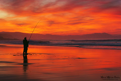Pescador al atardecer (Mimadeo) Tags: sunset red sea sky fish man beach silhouette reflections person evening fishing fisherman dusk hobby shore rod catch leisure rods seashore fishingrod sopelana fishingrods sopela