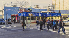 Old and New Perspective In Long Island City, Queens, NY (nrhodesphotos(the_eye_of_the_moment)) Tags: city nyc windows winter urban signs men cars rooftop students glass metal architecture vintage reflections season advertising island women shadows outdoor candid watertower displays pedestrians billboards poles autos crosswalk stores telephonepole cityview momaqueens signsstreet wwwflickrcomphotostheeyeofthemoment theeyeofthemoment21gmailcom dsc01759160 electricpolesandwires thenewthomsonsdiner museumsqueens blvdstreet lightsoutdoorsarchitecturenewoldmodernesquelong