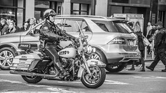NYPD Motor Squad Officer (Oliver Leveritt) Tags: newyorkcity blackandwhite monochrome traffic manhattan streetphotography nypd harleydavidson cop motorcycle manhatten policeofficer motorcyclecop newyorkpolicedepartment motorsquad afsdxvrnikkor18200mmf3556gifed oliverleverittphotography nikond7100
