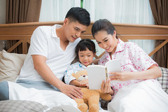Pretty couple with her daughter reading a book (anekphoto) Tags: life family woman house man male love home girl smile smiling yellow female asian thailand happy reading book parents bed bedroom couple asia day child with apartment adult affection father daughter young mother relaxing handsome posing lifestyle content indoors study domestic relationship together thai leisure domicile cheerful lying household homey