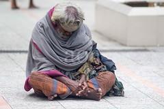 7D9_1015 (bandashing) Tags: street old portrait england people man face beard manchester sharif shrine rags courtyard sit mad contemplate sylhet bangladesh beg mentalhealth socialdocumentary mazar dargah aoa shahjalal bandashing akhtarowaisahmed