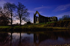 Abbey by night (images@twiston) Tags: park longexposure blue trees sky tree abbey grass silhouette parish stone architecture night reflections river stars landscape lowlight ruins branch estate nightshot branches yorkshire silhouettes illuminated moonlit monastery nighttime national bolton orion moonlight nightsky silhouetted priory northyorkshire dales afterdark devonshire boltonabbey 1154 wharfe augustinian dissolutionofthemonasteries yorkshiredalesnationalpark churchofstmaryandstcuthbert churchofsaintmaryandsaintcuthbert abbeybynight