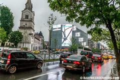 Auto vs fiets (Bart Weerdenburg) Tags: rain streetphotography romania bucharest regen bukarest stret boekarest roemenie straatftotografie