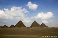 Triangles (Jorge M. Morando) Tags: old blue travelling clouds triangles contrast sand ruins desert egypt symmetry cairo historical pyramids egipto giza eg gizagovernorate