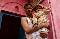 Father and son with colorful holi decoration, barsana, India (magbrinik) Tags: family pink india holi barsana traditionalculture mathura uttarpradesh childportrait indianfamily indianculture facesoftheworld colorfulportrait colorscontrast vrindavanholi