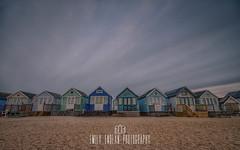 Mudeford Spit Beach huts at Dawn (Emily_Endean_Photography) Tags: sunset cold beach architecture sunrise landscape dawn coast early spring nikon colours spit huts beachhuts mudeford jurassiccoast