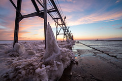(The Charliecam) Tags: sunset lighthouse cold ice water canon lakemichigan michiganfavorites grandhaven 6d 14mm rokinin