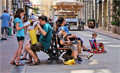 All in the Family (Hindrik S) Tags: street family people woman man color kids shopping children iso100 action candid sony streetphotography resting alpha tamron 1320 f28 vrouw 45mm active straat gezin a57 2015 frou famylje straatfotografie tamron1750 sonyalpha tamronspaf1750mmf28xrdiiildasphericalif gesin sonyphotographing strjitte slta57 57 hshlding strjittefotografy