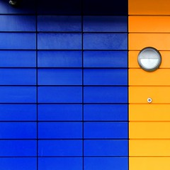 Singular force sq (Andrea Kennard) Tags: blue windows light red abstract lines yellow metal buildings square colours business shade colourful residential