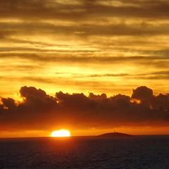 Sunrise in Guarapari - Brazil (Andre Zuin) Tags: ocean travel sunset sea brazil lighthouse sol clouds sunrise landscape mar paisagem nuvens farol ilha