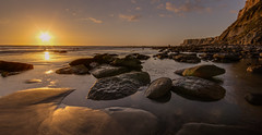 These rocks were made for walking (zebedee1971) Tags: light sunset red sea wild orange cliff sun sunlight seascape reflection beach clouds soft waves dusk tide serene rugged