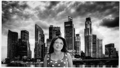 Dramatic Potrait (machixnation) Tags: city building girl smile clouds contrast skyscraper blackwhite potrait drama nikond750