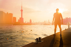 Shanghai. (arturii!) Tags: city trip travel light sunset sky urban orange sun sunlight man me beauty silhouette skyline architecture wow river myself amazing cool nice interesting dock holidays cityscape tour shanghai superb magic awesome great shoreline tourist wanderlust traveller route stunning viatge pearl moment oriental visual staring vacations sunbeam impressive gettyimages facing wonderlust arturii arturdebattk canonoes6d contemplatinf