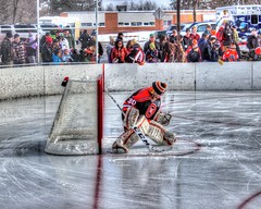 Hockey Warmup (mazzmn) Tags: winter cold reflection ice sports hockey lines minnesota goal goalie rink grandrapids fans hdr hss hockeyday thunderhawks gabeholum