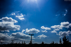 clouds (Georgina ) Tags: trees clouds telephone bluesky poles sunrays telephonewires hydropoles