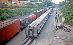 Freight Train Still Rolling (craigsanders429) Tags: amtrak passengertrains passengercars passingtrains mattoonillinois amfleet amtraktrains amtrakstations amfleetequipment amtrakinillinois amtraksshawnee amtrakinmattoonillinois