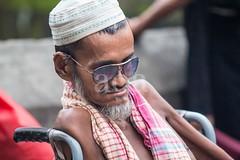 7D9_1029 (bandashing) Tags: street old portrait england man sunglasses beard manchester shrine wheelchair disabled sylhet bangladesh beg mentalhealth socialdocumentary beggars mazar dargah aoa shahjalal bandashing akhtarowaisahmed