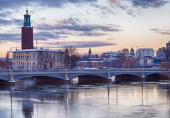 Early Morning Stockholm (faraz.azhar) Tags: morning bridge lake reflection water architecture clouds sunrise buildings river se sweden stockholm arches clocktower townhall stockholmsln farazazhar