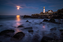 Moonrise at Portland Head Light (BenjaminMWilliamson) Tags: ocean usa moon seascape beach me night clouds reflections landscape photography coast photo twilight scenery surf waves image maine scenic newengland rocky landmark icon tourist historic gifts moonrise prints moonlight bluehour iconic attraction portlandheadlight